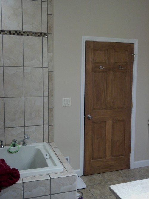 Keep wood door with white trim or stain everything for Combining stained and painted trim