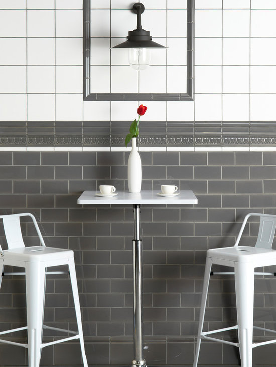The Artworks Collection - From the Artworks collection, Brilliant White field tiles with contrasting grout, London Stone half tiles and Sigma ,Victoria, Albert, Egg & Dart skirting and detail tiles. Gray and white is a classic combination and gives a softer look than black and white.