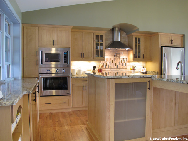 Kitchen With Stainless Steel Appliances And Light Wood