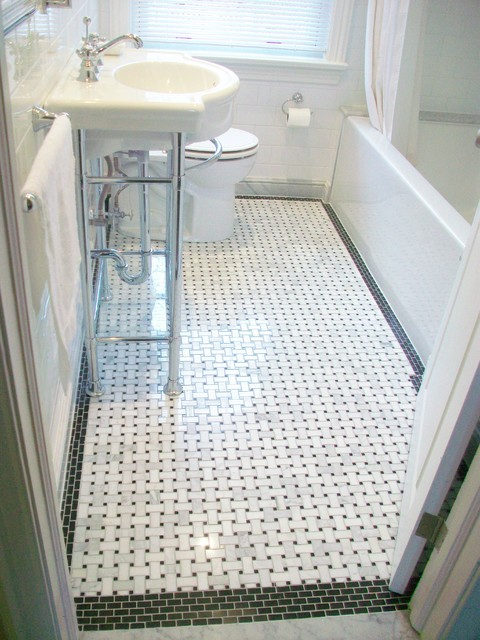 Bathroom reno with basketweave floor tile and black border accent tiles
