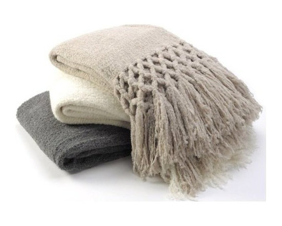 Sefte Living - Sefte Maya Boucle Throw - Light as a feather, warm as a fur coat, this beautiful, hand-woven throw will keep you snug as a bug in a rug. In your living room, it becomes an accessory with its eight inches of braided fringe. Toss it on the bed and it will add an interesting textural detail.