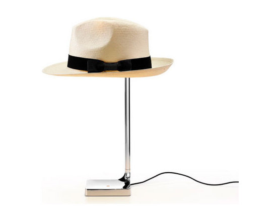 Flos Lighting - Chapo Table Lamp - The Chapo Table Lamp features a Chrome finish, and comes with one fedora-style hat. Use the included hat or use one of your own to create a different, customized personality. Features an optical switch on the base and a soft-touch dimmer. Also features a USB socket on the base, for charging most smartphones and tablets. One 8 watt 120 volt 2700K 93CRI 310 lumen LED module is included. 4.3 inch width x 15.7 inch height. UL listed.