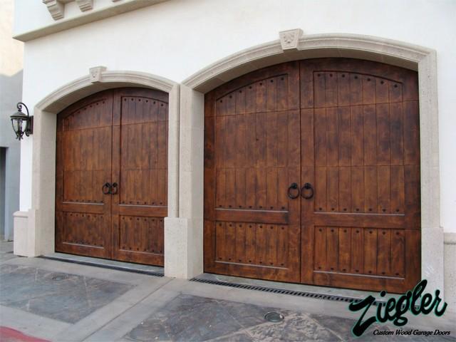 Mediterranean style garage doors mediterranean garage for Mediterranean style front doors