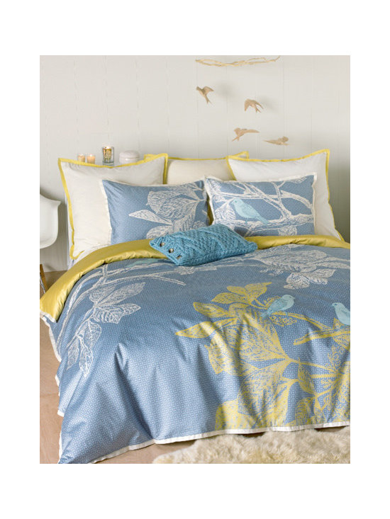 Icelandic Dream Duvet Set - Our Icelandic Dream duvet set finds its inspiration in Iceland's spare, pristine landscapes as well as its modern design influence. Etched motifs of blue birds resting on branches seem to float above a mosaic pattern in tone-on-tone slate blue. Duvet is accented with, and reverses to, hemp yellow; matching shams are designed form a continuous design when placed side-by-side. The complete set is finished with a tailored flange in cream.