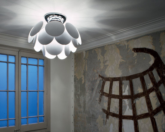Marset - Discoco Ceiling Flush Mount - Discoco Ceiling Flush Mount provides a dramatic play of light with soft shadows and is exuberant even when turned off. Comes in White, Turquoise Blue, Chocolate, Black/Gold, and Sand molded ABS thermoplastic discs with a Chrome finish. Available in small and large sizes. 23 watt, 120 volt Compact Fluorescent type medium base bulbs are required, but not included. Incandescent or LED equivalent bulbs can be used. Small: 20.87 inch width x 13.39 inch height. Large: 34.56 inch width x 21.46 inch height.
