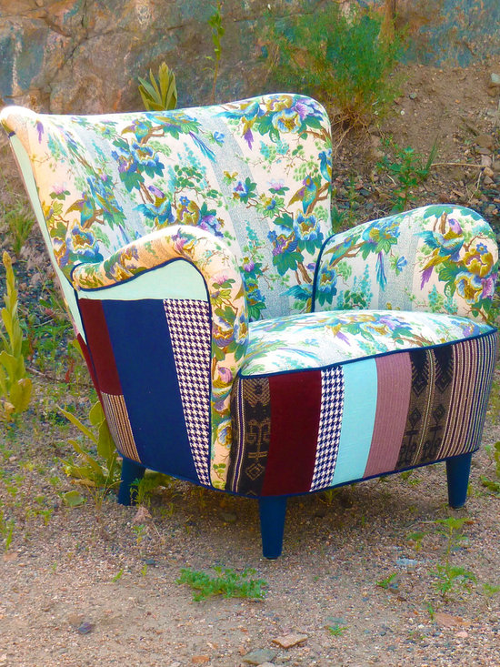 Vintage Furniture Redesigned - The front of this Mid-Century modern chair is covered in a vintage floral and bird pattern in an array of peacock-inspired colors consisting of cool blues, greens, and splashes of brown and purple. The front decking, back, and sides are covered in colorful vintage patchwork taken from a repurposed hammock, and featuring blue-and-white houndstooth and black-and-purple prints. This is vintage style at its finest.