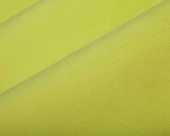 Princess Upholstery Fabric in Keylime - This lime green upholstery fabric has a suede and velvet-like pile that creates a decadent feel that's not easily forgotten. Super durable, yet soft and luxurious, this fabric is perfect for high traffic areas. Available in a multitude of colors, this fabric is a great solid to use as the basis for any design. Ideal for reupholstering chairs, sofas, ottoman, and more, or for creating custom bedding and pillows. Made from 100% polyester. Fire Rating: UFAC Class 1. 100,000 double rubs. Width: 54″