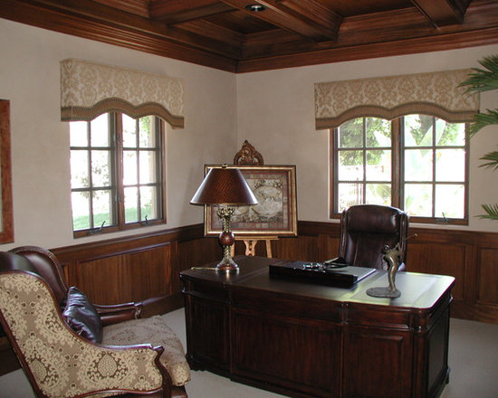 Cornice boxes - upholstered and shaped cornice boxes with contrasting border at hem and decorative nail-head accents.
