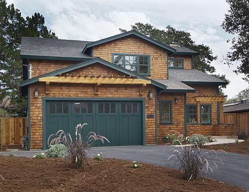 Natural Cedar Shingle Craftsman Home with Dark Green Garage Trim