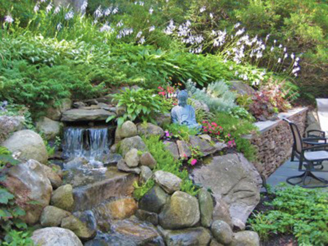 Patio with waterfall eclectic-landscape