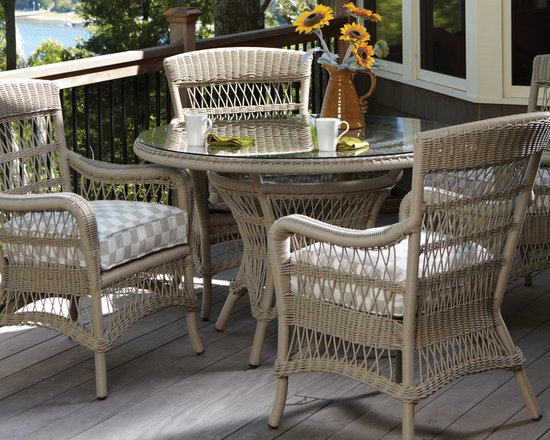 Lloyd Flanders Fairhope Dining Collection - The Lloyd Flanders Fairhope Dining Collection proffers flowing curves, woven elegance and open air styling, fossil coloration with plush, loose back cushioning. Perfect for outdoor patios, pools and decks.