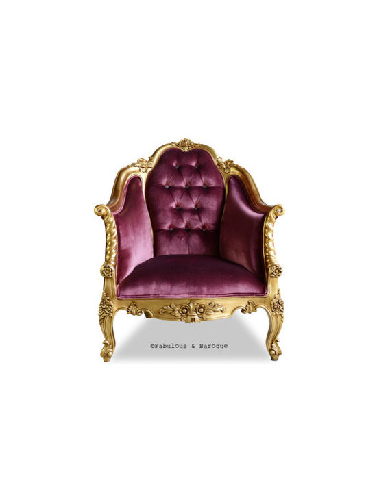 Violette Chair - Gold & Aubergine - Searching for the last piece to adorn your living room? Looking for something tasteful, elegant and refined? Behold the Violette Chair! The classic and timeless beauty of the Violette will surely make a statement, whether sitting next to a fire in the study, or in a luscious entryway; no will be able to deny its commanding presence.  The arched high back and tapered arms allow this chair to provide a sense of regal security and authority all at once. Finished in a brilliant gold leaf glaze and upholstered in a plush aubergine velvet with upholstered buttons. The finishing touch is all yours though, if you prefer a silver glaze and black crushed velvet upholstery, we aim to make your dreams come to life!