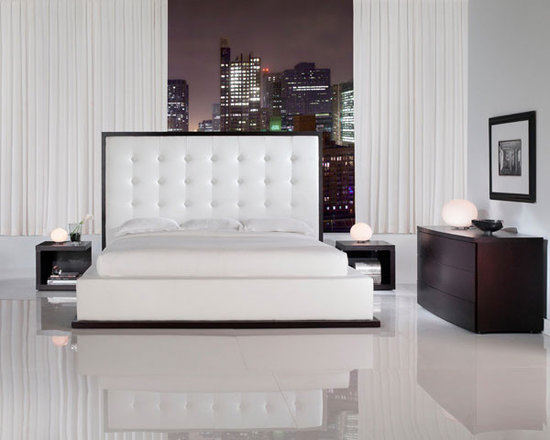 Ludlow Leather Bed By Modloft - The Ludlow Leather Bed is an opulent and luxurious option for any house that will definitely provide homeowners with a good night sleep. The most eye-catching aspect of the bed is its headboard,which towers at over five feet. Elegant in design,the bed is upholstered in leather and has a dotted/buttoned design.