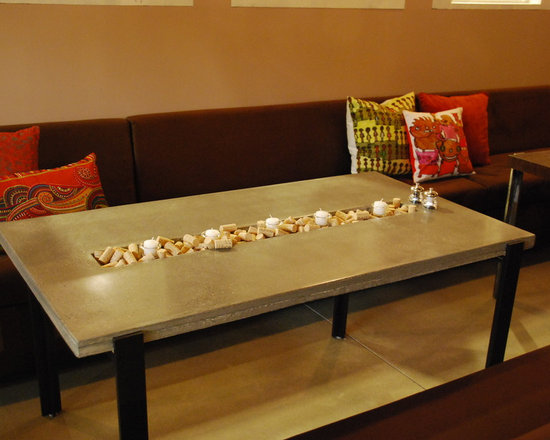 Whine - Polished concrete table with trough for candles and corks. Painted steel frame