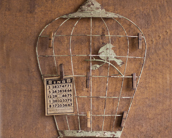 Birdcage Wall Hanging with Photo Clips - Lightly distressed metal in a close to the wall depiction of a bird in its cage with the added bonus of eight small clips with which to hang photos, memorabilia or notes to one's self.