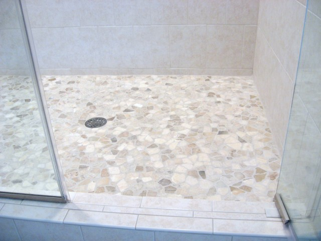 Brilliant This Might Be A Small Bathroom, But This Surely Didnt Stop The Designer, Robert Frank Interiors, To Go Big In Style! Its Chic Appeal Comes From The Stunning Stone Mosaic Floor Tiles And The Floor  The Countertop Is White Quartz By