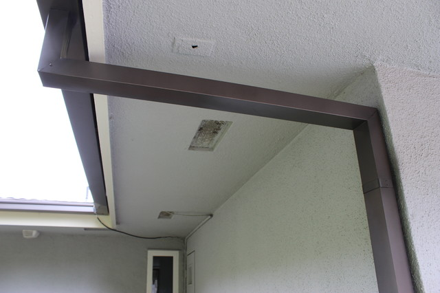 Modern Box Style Rain Gutters With 2x3 Downspouts In West