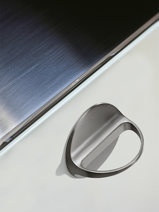 Ring Pull - DP202-17S - Round, low-profile base mounts flat against drawer surface. Base connects seamlessly with an arcing pull tab that projects straight out. Smooth lines all the way around make for a very elegant look.