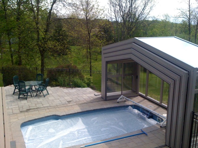 Retractable pool enclosures open with a push of a for Swimming pool enclosures prices