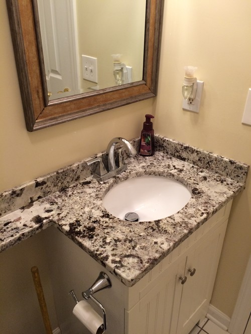 white bathroom vanity with marble top