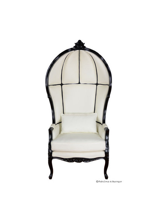 Victoire Balloon Chair - White & Black - The Victoire balloon chair is a natural addition to the Fabulous & Baroque collection of fine furnishing. The chair is a cozy, comfortable choice for any modern baroque setting. We've covered the inside and of the chair with faux white leather and then dressed it up by finishing the frame in a black lacquer finish! Handmade and carved out of mahogany, with accent carvings at the crest and base of the chair. Oblong pillow included.