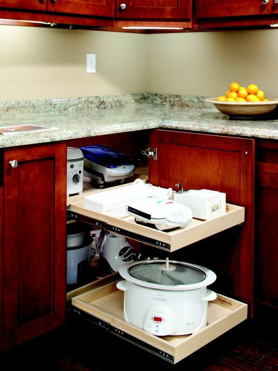 Blind Corner Solution - Use more of the available storage in your corner cabinets with ShelfGenie of Connecticut's blind corner cabinet solution.  When the front pull out shelf is extended, slide the corner pull out shelf over for easy access to the items stored in the corner.