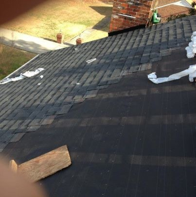 New roofing shingles on John Wilson's home and garage traditional