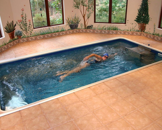 Endless Pools - Original Endless Pools®, Sunroom Pool, Inground Pool - Swimming al fresco (sort of). With its clever murals, earthen tile, and garden view, this spacious swim room brings nature's glory into your private aquatic haven.