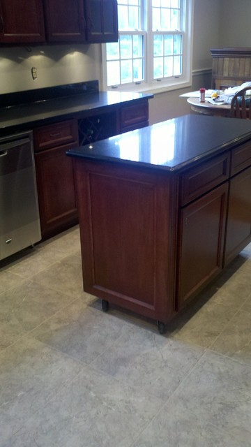 Traditional kitchen dark maple stained cabinets, black quartz counters- Fairfax traditional