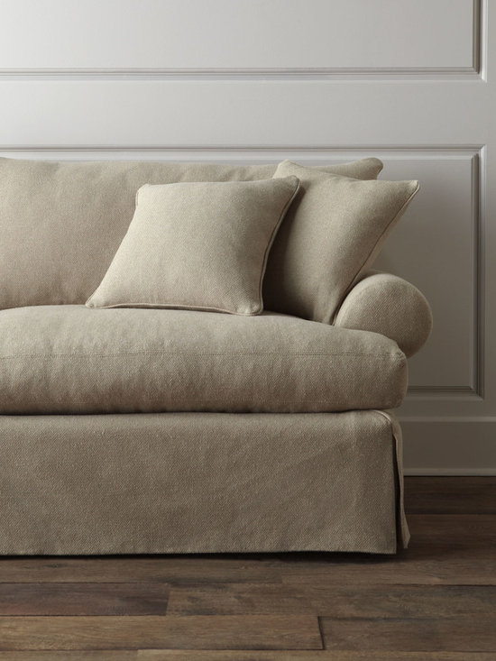 """Keystone"" Sofa - Overstuffed sofa with dressmaker-style skirt invites you to snuggle in and stay awhile. Its neutral coloration lets it blend well with a variety of decorating styles."