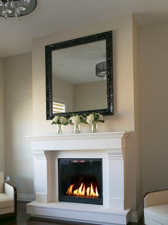 Concrete Fireplace Surrounds - The Estate Mantel designed and handmade by DEKKO Concrete.  This mantel is made of lightweight concrete and designed to fit to any square or rectangular gas fireplace.   Available in 6 colors and available for shipment worldwide.