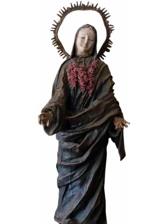 life sized papier-mâché - An incredible statue made of heavy paper over wood, out of a church in San Francisco circa 1880. Her hands are lovely old and gnarled, her face so serene.