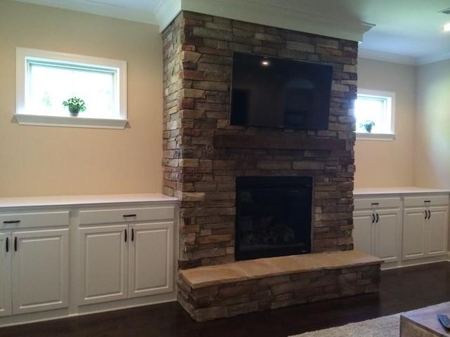 Custom Cabinet Built ins beside Fireplace