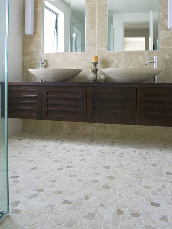 Island Stone random pebble floor - Random Tile brings a unique and dramatic design statement to any space. Using unique random shaped and sized stones to we create customized tiles that interlock seamlessly to cover any area. Our unique means of  individually creating each interlocking tile insures that your installation will be completely custom, while retaining the premier look and quality for which we are known.