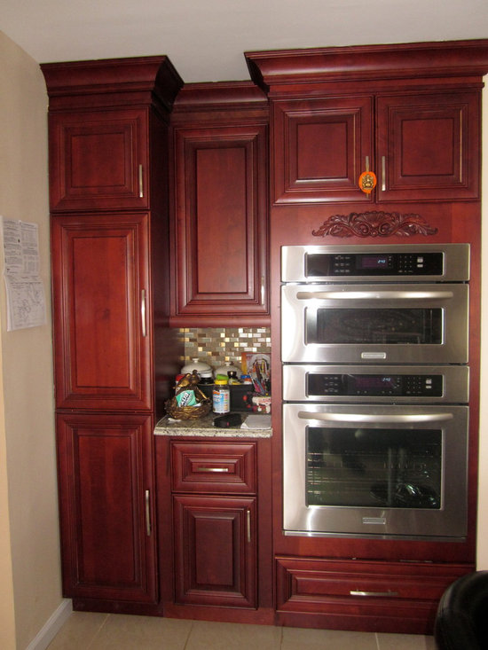 O'Neil Cabinets Cherry Door Style - O'Neil Cherry oven cabinet with pantry.