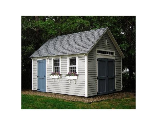 "12' x 16' Quivett - The front and one gabled end of this Quivet is primed clapboard in the Driftwood color.  The remaining walls have board and batten siding.  It has 7' wall height and 30 year architectural roof shingles.  There are two 30"" x 49"" PVC double hung windows an a 6' PVC transom window above the 6' two-paneled bead board double door.  On the side is a 36"" two-panel bead board door. Windows have standard pine window boxes."