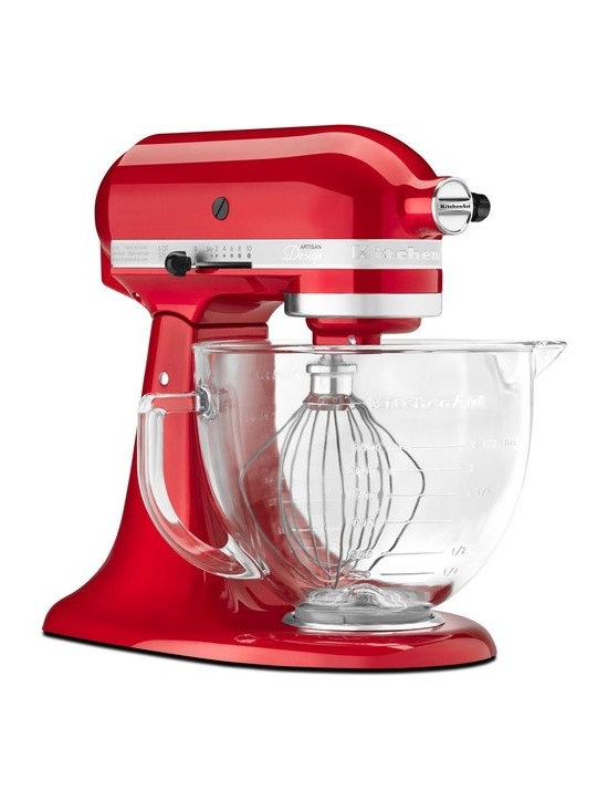 KitchenAid - Artisan Designer Series Stand Mixer - The KitchenAid Artisan Designer Series Stand Mixer brings innovation and style to your kitchen. The 10 mixing speeds provide flexibility and control whether you're creating a new recipe for cupcakes or your famous herb mashed potatoes. And the tilt-back head provides easy access to check on ingredients or change accessories. This stand mixer makes your kitchen dreams a reality. With measurement markings on the side in liters and cups, the glass bowl is handy, beautiful and multi-functional. Simply remove the round, metal medallion on the front of the mixer, attach the accessory to the power hub and you're ready to grind choice meats, prepare fresh applesauce or make delicious, homemade pasta. Features: -Stand mixer.-Multi-purpose attachment hub.-Planetary mixing action.-Tilt-back head feature.-Locking lever keeps mixer head in down position.-Handles up to 9 cups of all-purpose flour.-Mashed potato yield: 7 pounds.-Use the dough hook for breads, pizza dough and yeast rolls.-Whip perfect icings with the wire whip from main dishes to dessert.-5 Quart glass bowl with measurement markings on side.-Metal construction.-Collection: Artisan.-Distressed: No.-Country of Manufacture: United States.Specifications: -325 Watt Motor.Dimensions: -Dimensions: 14'' H x 8.3'' W x 14.3'' D.-Overall Product Weight: 25.5 lbs.Warranty: -Flat beater, wire whip, manual, warranty.