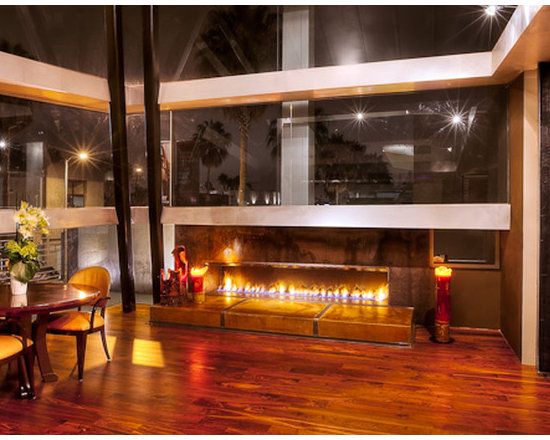 Space Abbott Kinney - 8 Foot Steel faced linear fireplace with steel strapped custom colored and stained concrete hearth.