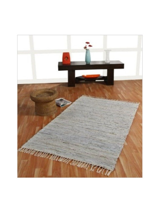 Leather Glitter Rug Silver & Natural - This rug has been hand made on traditional handlooms in India. It is manufactured with recycled leather cuts interwoven with natural gold and silver yarns to make this a sturdy, long lasting and beautiful rug