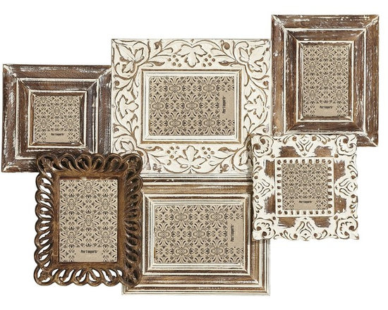 Hand-carved Wall Collage - Try a wall collage with groupings of mismatched frames. They will fill up your blank wall and create a great conversation piece. Plus, you'll be able to display your favorite moments for family and friends.