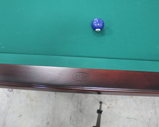 Michigan Made Custom Pool Tables - Add a McClure custom made pool table to your basement today.  Our tables are made from one hundred percent North American maple wood. All of our tables are made from old world craftsmanship and bring a unique style to your home.  Each table is handmade within our Grand Rapids, Michigan facility. Not only is this a great addition but it also allows you, your friends and family to compete against one another and stay entertained all day and night!