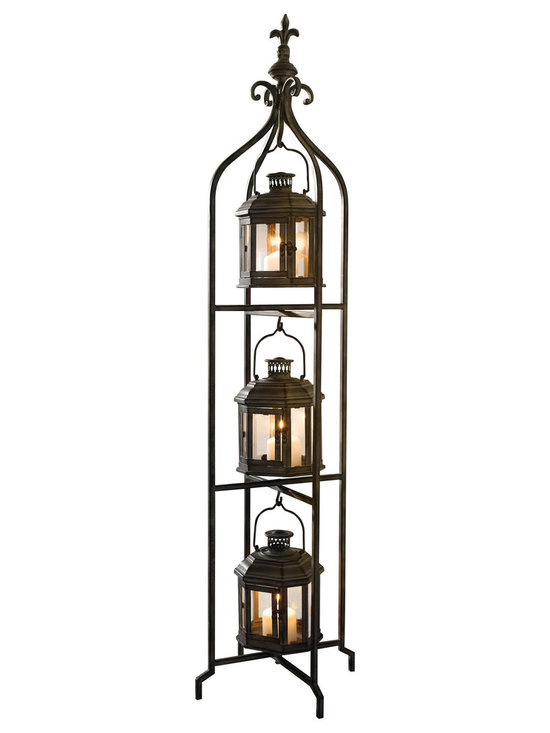 Pier Surplus - Metal Candle Lanterns with Stand - Three-tier Lantern Stand for Yard #CL221880 - This three-tier stand is a graceful way to give light to your patio area or an indoor corner. Three candle lanterns are housed within a a sturdy metal frame finished in black and topped with a fleur-de-lis motif. Add an exotic touch of mystery and worldliness to any evening's entertainment. Each lantern completely encases candles so they burn safely. A sophisticated way to provide soft light at a wedding reception.