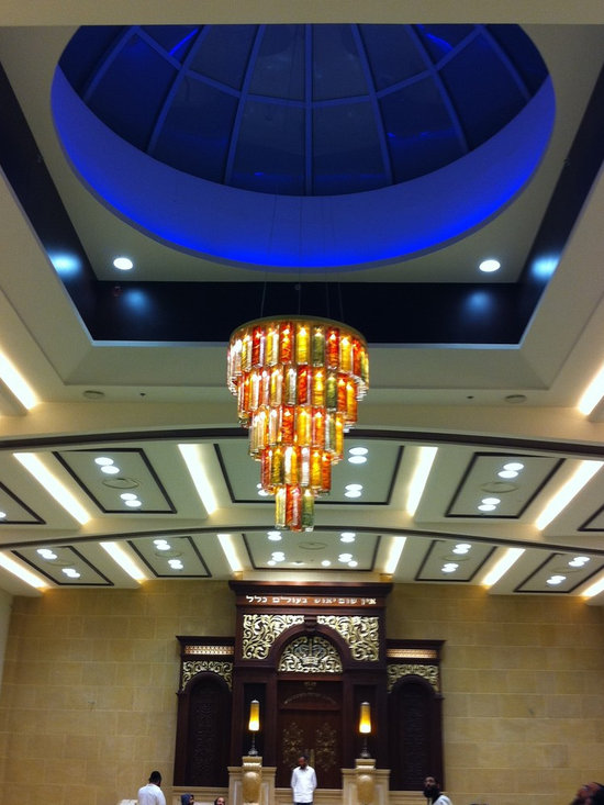 Exotic candles - A beautiful art glass that make a breathtaking chandelier, hand made and created by our artist. we specialize in custom design and all our products are available in other colors, sizes, and canopies.