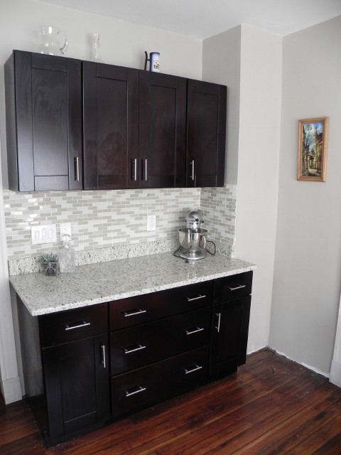 Bronze Hinges And Handles On Dark Wood Kitchen Cabinets
