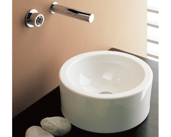 "Scarabeo - Trendy Round White Ceramic Contemporary Sink by Scarabeo - This trendy circular white ceramic bathroom sink is designed and manufactured in Italy by Scarabeo. Contemporary above counter vessel sink without overflow. Sink contains no faucet holes. Sink dimensions: 14.60"" (width), 5.90"" (height), 14.60"" (depth)"