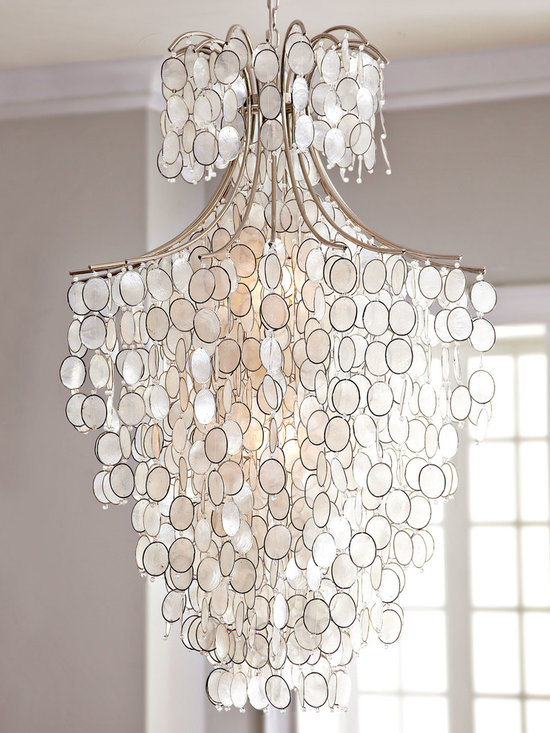 Lighting - Elegant to the extreme, this impressive chandelier features cascades of white capiz shells that have been carefully hand cut and individually attached to the steel framework.