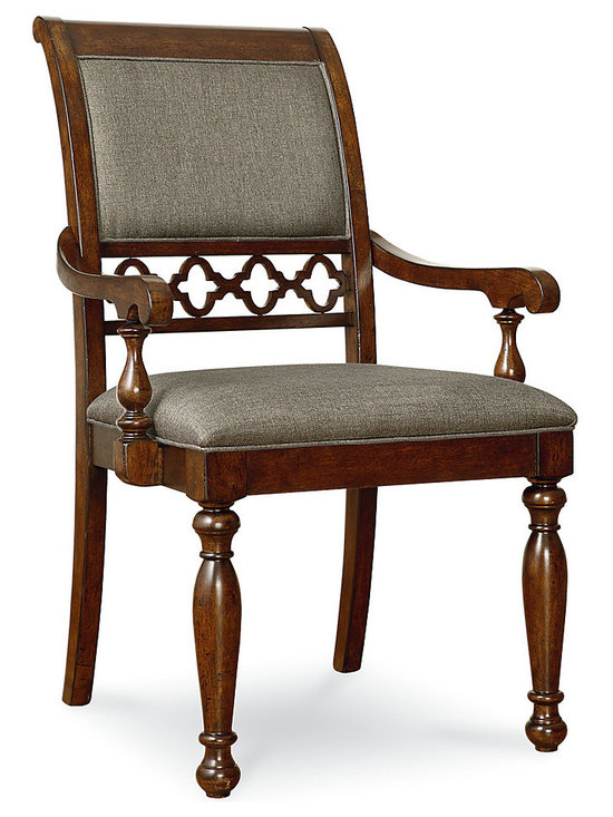 Thornhill Upholstered Arm Chair, Set of 2 - Guests are certain to linger in this exquisite set of two upholstered arm chairs with fretwork detailing. Crafted from quality poplar solids and cathedral cherry veneer, these chairs are finished in cinnamon. Upholstered with gray fabric on the seat and back, these chairs are comfortable for meals of any length. An eye-catching open fretwork panel added to the back truly elevates the style of these chairs. An ideal choice for the traditional or transitional home, these dining chairs are a comfortable, beautiful selection.