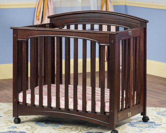 Child Craft - Child Craft Stanford Mini Folding Crib and Mattress in Cherry - Featuring a rich cherry finish,this crib features an arched headboard styling typically found only on convertible cribs. The two-position adjustable posture board allows highest position to be used as a bassinet.