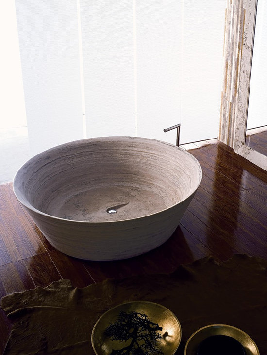 BEACH Bathtub - Available in Travertino Classico, Travertino Becagli, Travertino Noce, Travertino Bianco Rapolano, Travertino Dorato, Marmo Bianco Carrara, Marmo Arabescato, or Ardesia. Dimensions are 162cm x 162cm x 50cm. Weighs 550 kg. Access to this tub and our full catalog of hand-chiseled natural stone is available at theverostone.com