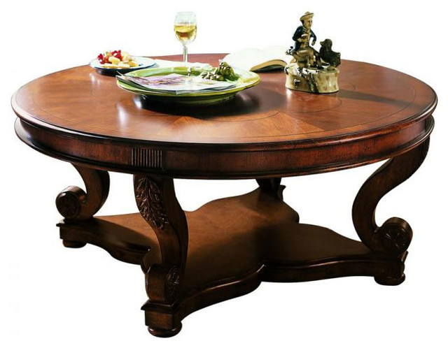 Raylen vineyards round cocktail table mediterranean What to put on a round coffee table
